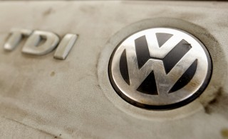 Volkswagen's logo is seen on a TDI diesel engine of its EOS car in Zurich, Switzerland, September 22, 2015. Volkswagen shares plunged more than 20 percent on Monday, their biggest ever one-day fall, after news that the German carmaker had rigged U.S. emissions tests, and Germany said it would investigate whether data had been falsified in Europe too.  REUTERS/Arnd Wiegmann