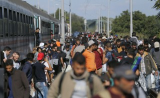 Migrants disembark from a train after arriving at the station in Botovo, Croatia September 23, 2015, before walking to the Hungarian border. Hungarian leader Viktor Orban said on Wednesday he would propose that European Union states pay more into the EU budget to help cope with the refugee crisis and that Greece should allow other countries to defend its borders to slow the influx. Hungary lies in the path of the largest migration wave Europe has seen since World War Two and has registered more than 220,000 asylum-seekers this year.  REUTERS/Antonio Bronic - RTX1S22R