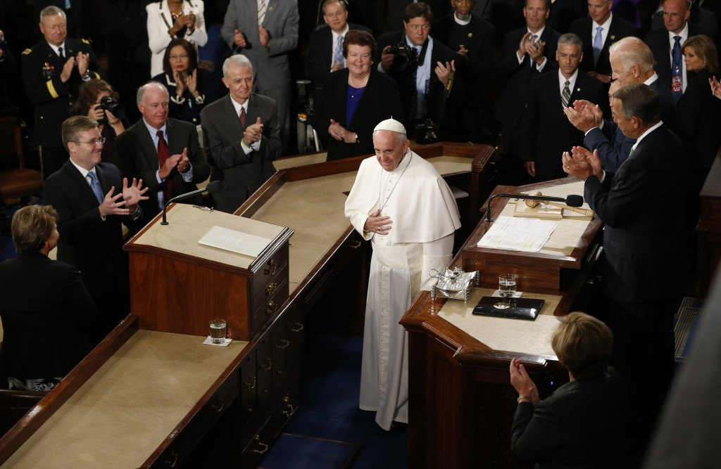Speaker of the House John Boehner (right) and Vice President Joe Biden (right, top) applaud as Pope Francis arrives to give his speech to the U.S. Congress in Washington, D.C., on Sept. 24. Photo by Jonathan Ernst/Reuters