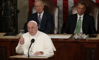 Pope Francis addresses a joint meeting of the U.S. Congress as Vice President Joe Biden (L) and Speaker of the House John Boehner (R) look on in the House of Representatives Chamber on Capitol Hill in Washington September 24, 2015.   REUTERS/Kevin Lamarque (TPX IMAGES OF THE DAY)   - RTX1S9J9
