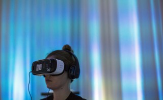 "A person uses Gear VR virtual reality headsets during a preview session in Hollywood, California September 24, 2015. Oculus and Samsung Electronics unveiled a new version of Gear VR virtual reality headset for $99, half the price of the previous ""Innovator Edition"", and said the product would be available in the United States in time for Black Friday and globally shortly after.  REUTERS/Mario Anzuoni - RTX1SCYV"