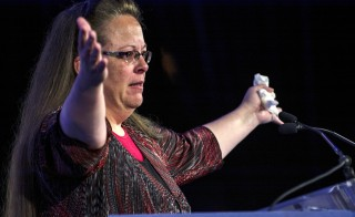 "Kentucky's Rowan County Clerk Kim Davis, who was briefly jailed for refusing to issue marriage licenses to same-sex couples, makes remarks after receiving the ""Cost of Discipleship"" award at a Family Research Council conference in Washington on Sept. 25, 2015. Photo by James Lawler Duggan/Reuters"