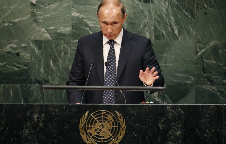 Russian President Vladimir Putin addresses attendees during the 70th session of the United Nations General Assembly at the U.N. Headquarters in New York, September 28, 2015.  REUTERS/Mike Segar - RTX1SWUL