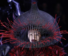 """A model wears a demented woven basket on her head by British designer Alexander McQueen as part of """"Horn of Plenty,"""" his 2009 ready-to-wear women's collection during Paris Fashion Week Photo by Pascal Rossignol/Reuters"""