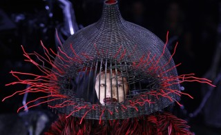 "A model wears a demented woven basket on her head by British designer Alexander McQueen as part of ""Horn of Plenty,"" his 2009 ready-to-wear women's collection during Paris Fashion Week Photo by Pascal Rossignol/Reuters"