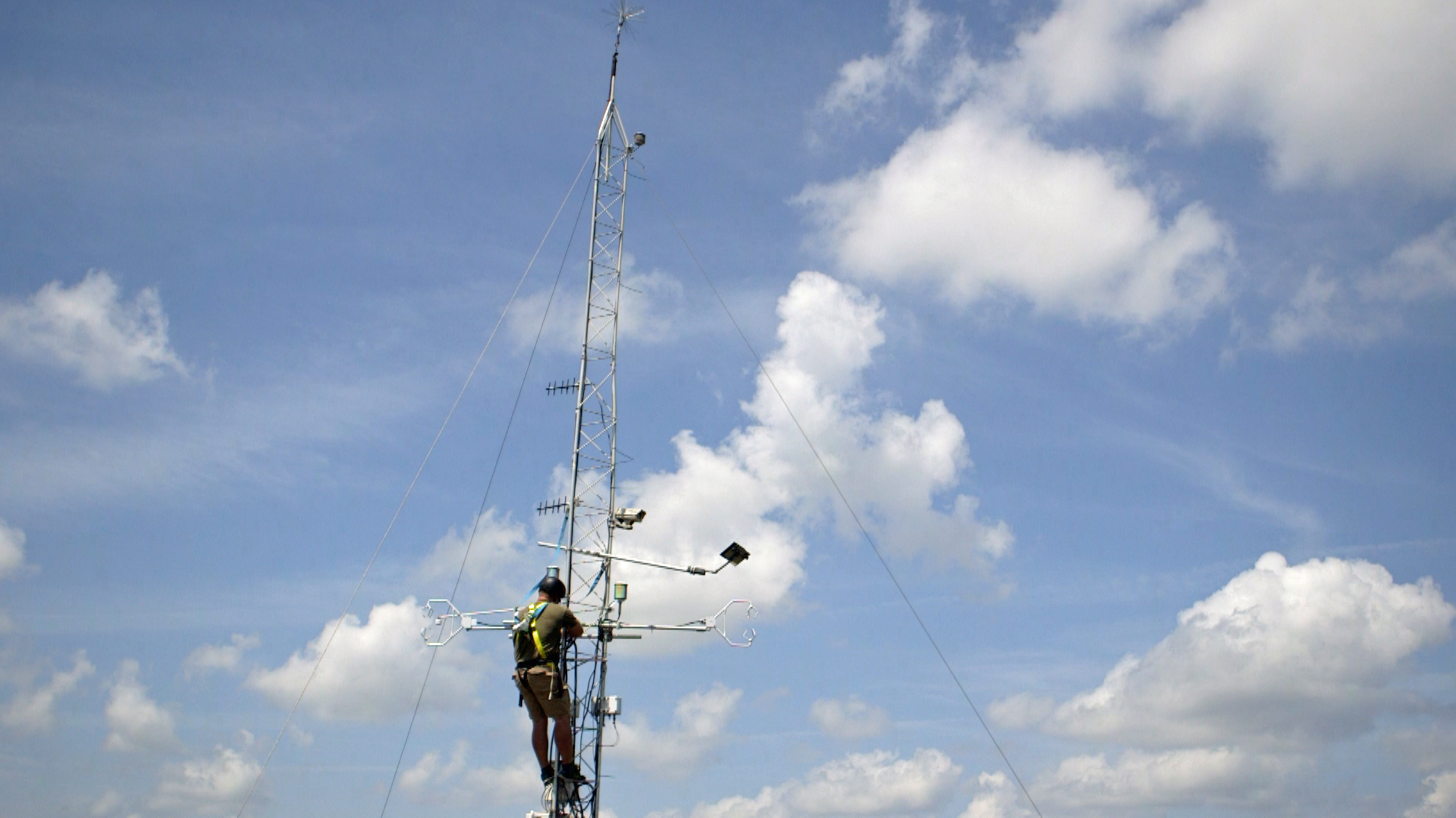 Marine scientist Jacob Shalack climbs the flux tower on Sapelo Island. Photo by Mike Fritz