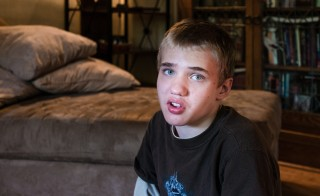 Alexander Brown, 14, sits in his living room on Thursday, May 14, 2015.  He was diagnosed with autism at 18 months. Alexander is having a hard time with puberty and is lashing out physically. Photo by Heidi de Marco/KHN