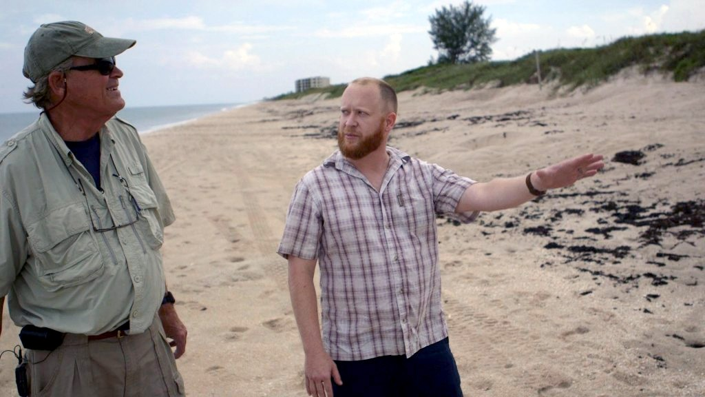 "Biologist Joshua Reece (right) and Llewellyn ""Doc"" Ehrhart chat about sea turtle nesting at Archie Carr National Wildlife Refuge. Photo by Mike Fritz"