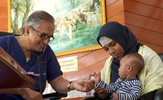 Dr. Devi Prasad Shetty, heart surgeon and founder of Narayana Health, meets with patients in India. The group, founded in 2000, now has more than 30 hospitals. Photo by Rakesh Nagar for the PBS NewsHour