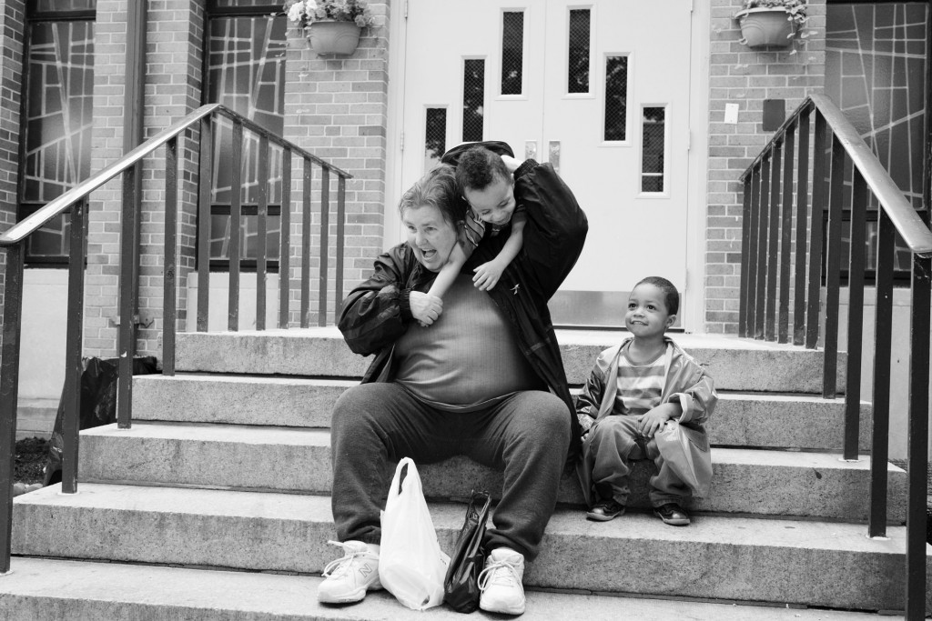 "Carol, one year after her release, with her honorary grandchild Cecil, right, and Darjay, middle, both almost three years old, in Long Island City, New York City. ""I've always loved kids. They're so innocent and full of joy. In prison, I wasn't allowed to work on the nursery because I had a violent crime. Now it's my chance. For 35 years I've been away from my own children. You can't blame them for being angry and disappointed and hurt. I hope one day they'll forgive me."""