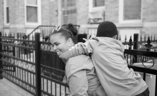 """Evelyn with the son of her domestic partner in Long Island City, New York City. """"I met my partner when I'd only been home for a few days. She has three kids and me not having kids, I became close to the kids and that was an extra."""" Photo and caption by Sara Bennett"""