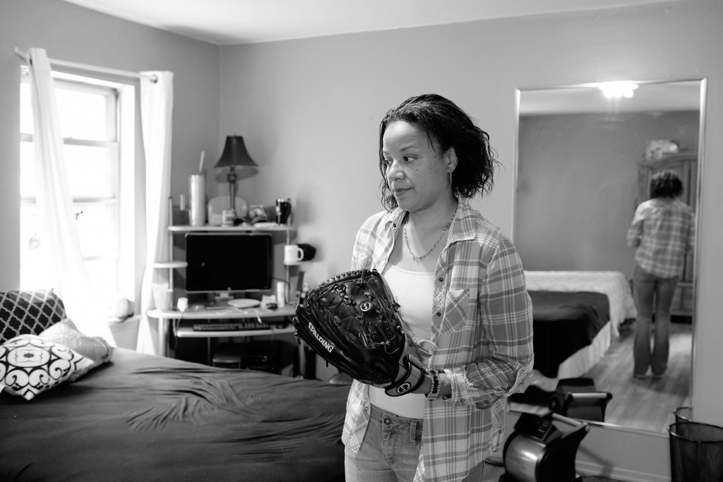 """My dad bought me this softball glove when I joined the prison team. He died while I was in there. Two officers transported me to the funeral home. They wanted me to go in without my family. I couldn't. I didn't care about their rules and regulations. It was my father. He was my everything. I was in cuffs for twenty hours. He was the man I loved the most in this whole world. It just went all wrong. They made it worse."" Caption courtesy of Sara Bennett. Photo by Sara Bennett"