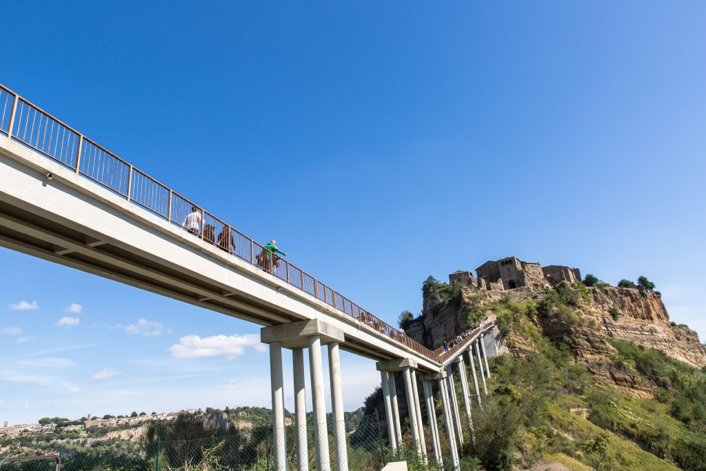 Tourists and residents access Civita di Bagnoregio by way of a steep footbridge. But earlier this year there was a collapse near its base that now needs shoring up. Photo by Frank Carlson
