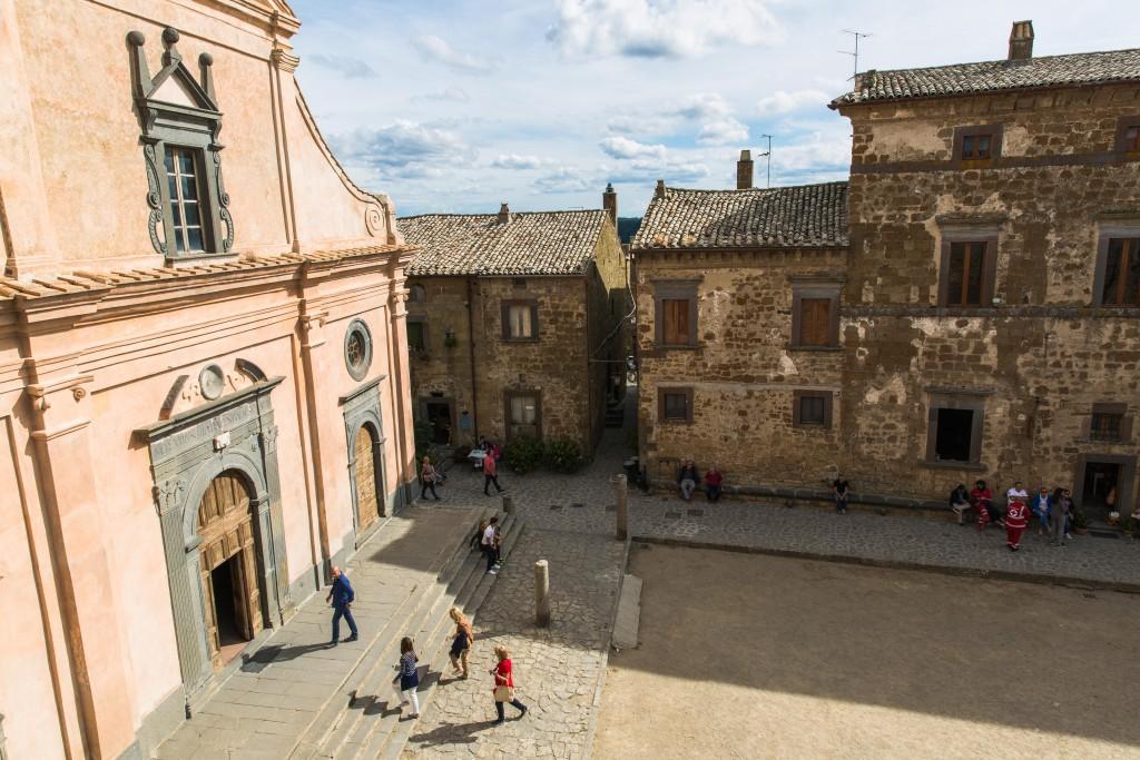 Tourists arrive at the main square of Civita di Bagnoregio, where the San Donato church sits. Photo by Frank Carlson