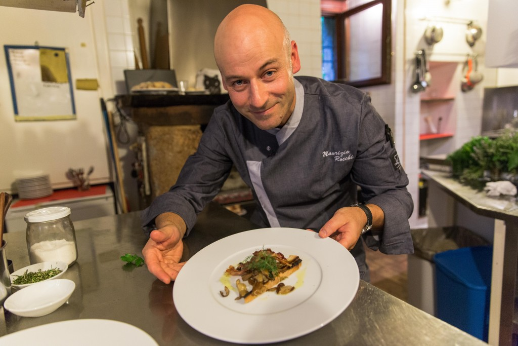 Chef Maurizio Rocchi shows off one his family recipes, featuring bacon, egg yolk and black truffle flakes. He is one of the few year-round residents here, and has opened a new restaurant, the Alma Civita, to capitalize on the growth in tourism. Photo by Frank Carlson