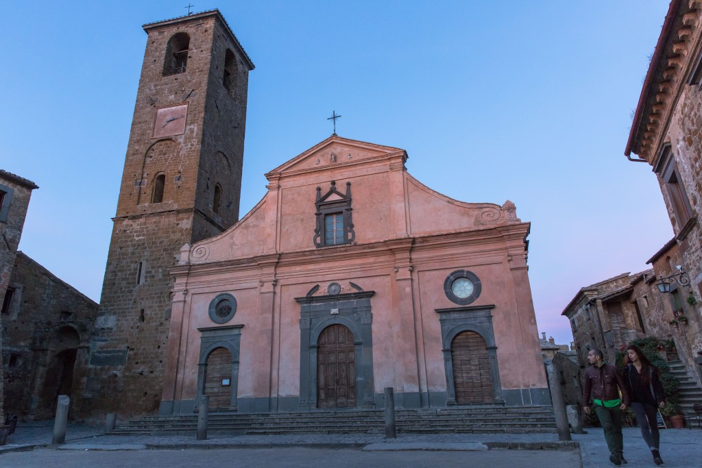 At dusk tourists leave the main square, passing the San Donato church on their way out. Photo by Frank Carlson