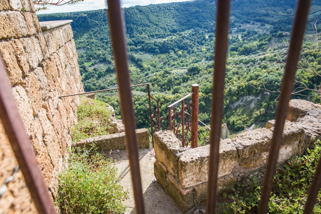 For hundreds and even thousands of years, the town of Civita di Bagnoregio has been gradually falling apart due to landslides. Here a gate prevents tourists from descending a staircase that leads off a cliff. Photo by Frank Carlson