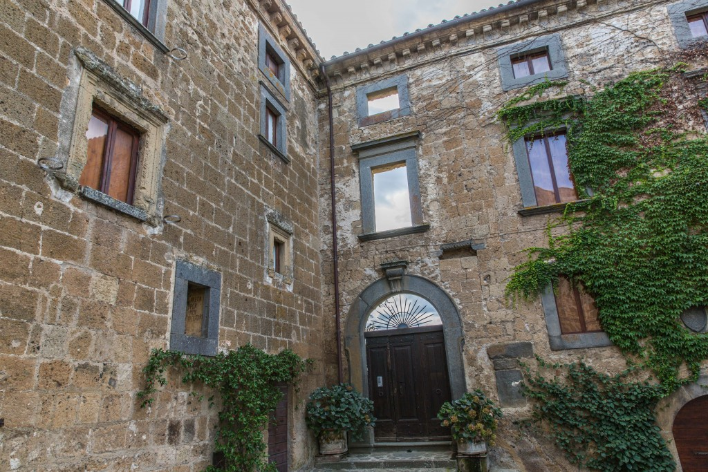 Some 20 percent of Civita di Bagnoregio's land has been lost since 1705, most of it gardens and agricultural lands. But buildings have also been lost, like this one, now a mere facade. Photo by Frank Carlson