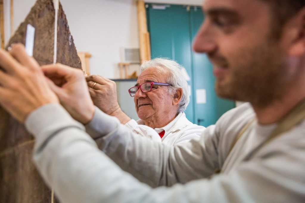 """Ciro Castelli was a young carpenter when the 1966 flood hit, and through the emergency response became involved in wood restoration. He's now a master woodworker who came out retirement to work on Vasari's """"Last Supper,"""" as well as to teach a new generation of wood restorers his techniques. Photo by Frank Carlson"""