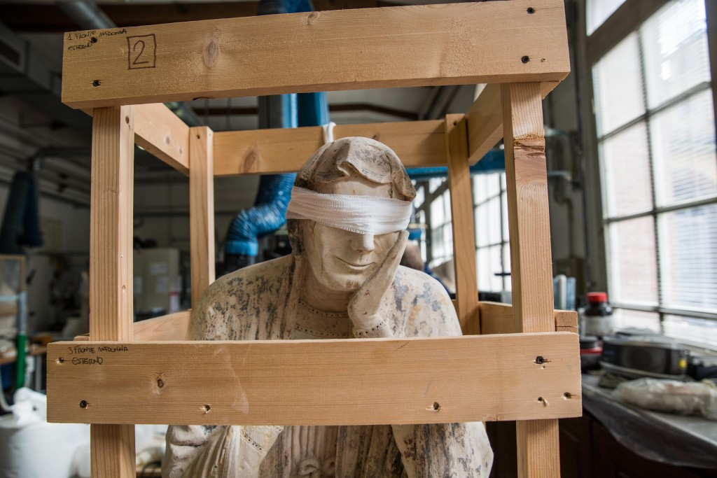 A sculpture awaits restoration in the museum workshop of the Opificio delle Pietre Dure in Florence, Italy. Photo by Frank Carlson