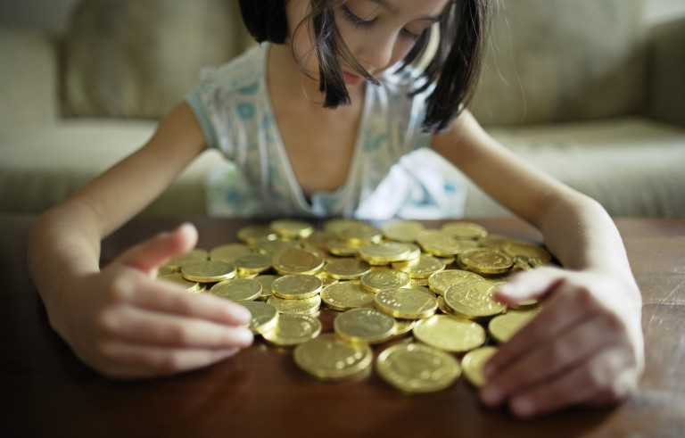 Girl with chocolate coins