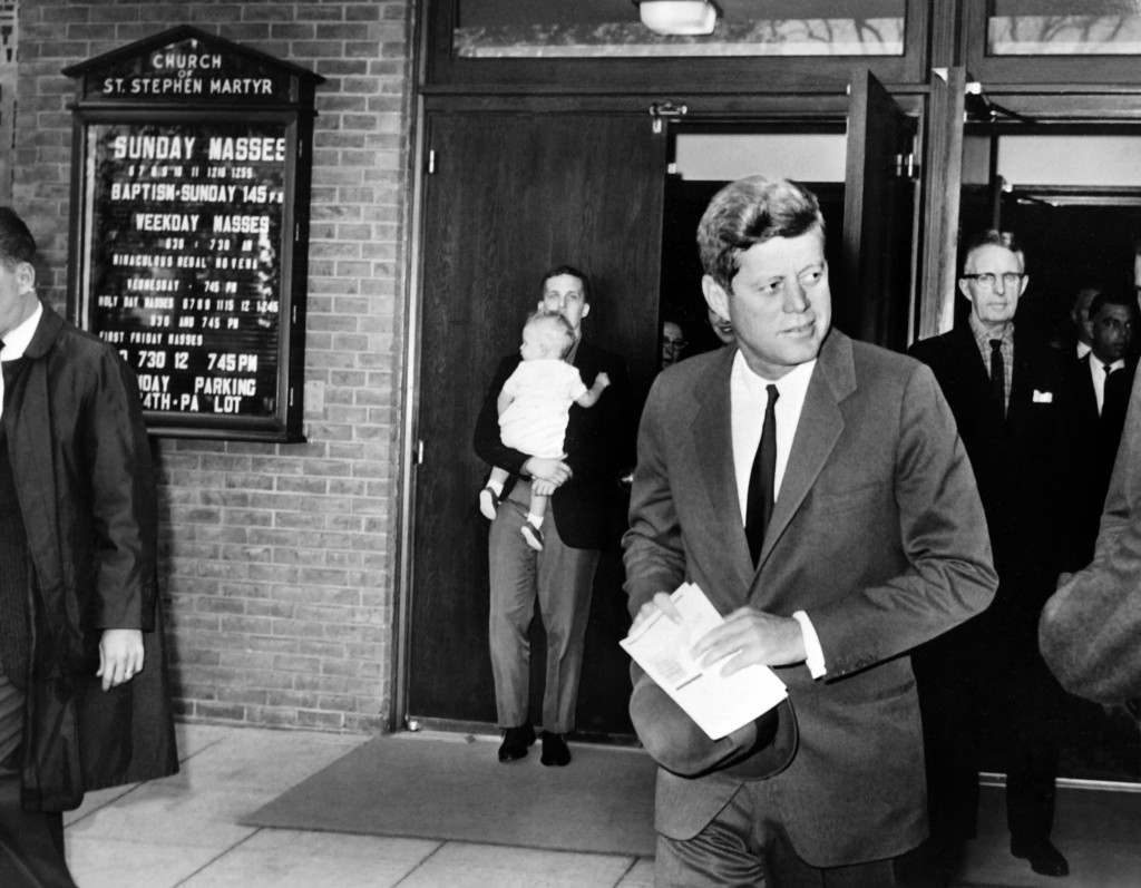 President John F. Kennedy leaves the St. Stephen Martyr Catholic Church after attending Mass on Oct. 28, 1962 in Washington, D.C., a few hours before Soviet leader Nikita Khrushchev offers to retire the Soviet missiles from Cuba. Photo by STF/AFP/Getty Images