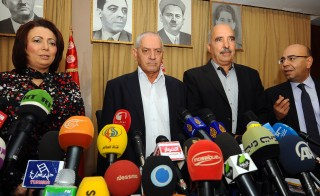 Tunisian mediators arrive to give a press conference to announce the result of its latest bid to mediate an end to the crisis on September 21, 2013 in Tunis. (LtoR) The President of the Tunisian employers union (UTICA), Wided Bouchamaoui, Secretary General of the Tunisian General Labour Union (UGTT) Houcine Abbassi (L) , President of the Tunisian Human Rights League (LTDH), Abdessattar ben Moussa and the president of the National Bar Association, Mohamed Fadhel Mahfoudh. Tunisia's ruling Islamist party, Ennahda announced on September 20, 2013 that it has accepted an ambitious roadmap proposed by the mediators to form a government of technocrats and resolve the country's two-month-old political crisis.  AFP PHOTO / FETHI BELAID        (Photo credit should read FETHI BELAID/AFP/Getty Images)
