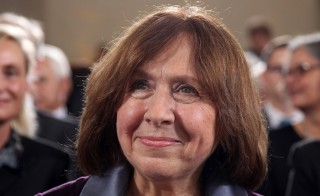 Belarusian journalist and writer Svetlana Alexievich smiles during her awarding ceremony of the German Book Trade Peace Prize on October 13, 2013 at the Paul's Church in Frankfurt am Main, western Germany. The German Book Trade Peace Prize (Friedenspreis des Deutschen Buchhandels) is awarded since the year 1950 and is worth 25,000 euros. AFP PHOTO / DANIEL ROLAND        (Photo credit should read DANIEL ROLAND/AFP/Getty Images)