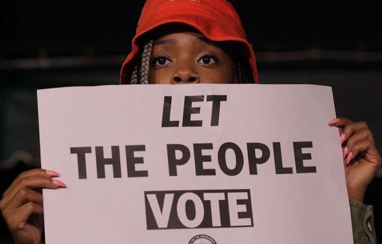 GREENSBORO, NC - NOVEMBER 3:   Keyanna Morrow (cq Keyanna), 19, holds a voter rights sign during a Moral March to the Polls event sponsored by the North Carolina NAACP in Greensboro, NC, on Monday, November 3, 2014.  (Photo by Ted Richardson/For The Washington Post via Getty Images)