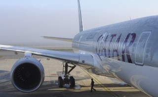 A person walks near one of the two Airbus A350-900 aircrafts for the Qatar Airways company on December 22, 2014 at the Airbus Group center in Toulouse, southern France. The A350, whose wings and fuselage are made of carbon fibre, is designed to save up to 25 percent in fuel consumption while serving long-range routes. Qatar Airways has ordered 80 of the aircraft and plans to make them the workhorse of its fleet. AFP PHOTO / ERIC CABANIS        (Photo credit should read ERIC CABANIS/AFP/Getty Images)