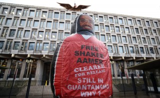 A giant inflatable figure of Shaker Aamer, the last Briton to be detained in Guantanamo Bay, is pictured during a protest by the We Stand With Shaker campaign group outside the U.S. Embassy in London on Feb. 13, 2015. Photo by Carl Court/Getty Images