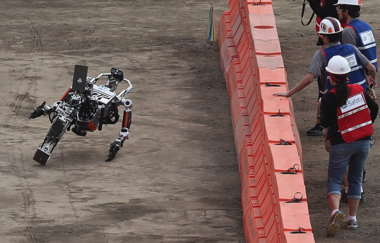 ESCHER (Electromechanical Series Compliant Humanoid for Emergency Response) robot takes a tumble at the Defense Advanced Research Projects Agency Robotics Challenge June 5, 2015 in Pomona, California. Photo by Chip Somodevilla/Getty Images