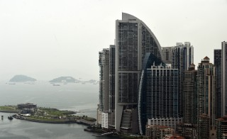 The Trump Ocean Club (the tallest building shown) in Panama City, July 30, 2015. The building has been the scene of a drawn out fight between residents and Trump's management team over allegations of financial overruns, lack of transparency in management and undisclosed executive bonuses. Photo by Rodrigo Arangua/Getty Images