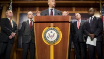 UNITED STATES - OCTOBER 1: Sen. Cory Booker, D-N.J.,   flanked from left by Senate Minority Whip Dick Durbin, D-Ill., Senate Judiciary Chairman Chuck Grassley, R-Iowa, Senate Judiciary ranking member Pat Leahy, D-Vt., Sen. Sheldon Whitehouse, D-R.I., and Sen. Tim Scott, R-S.C., speaks during the news conference on criminal justice reform legislation on Thursday, Oct. 1, 2015. (Photo By Bill Clark/CQ Roll Call)