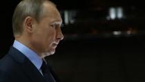 SOCHI, RUSSIA - OCTOBER 06: Russian President Vladimir Putin awaits to greet Tajik President Emomali Rakhmon during their meeting at Bocharov Ruchey State Residence on October 6, 2015 in Sochi, Russia. (Photo by Sasha Mordovets/Getty Images)