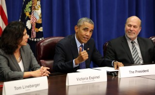 President Barack Obama meets with agriculture and business leaders on the benefits of the Trans-Pacific Partnership for American business and workers, at the Department of Agriculture in Washington, Tuesday, Oct. 6, 2015. Flanking the president are Victoria Espinel, CEO, The Software Alliance (left); and Bob Stallman, Jr., President, American Farm Bureau. Photo by Pool / Getty Images