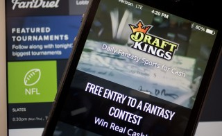 Fantasy sports sites DraftKings FanDuel attract players to games that pay out millions of dollars in cash prizes in daily contests. Photo by Andrew Harrer/Bloomberg via Getty Images