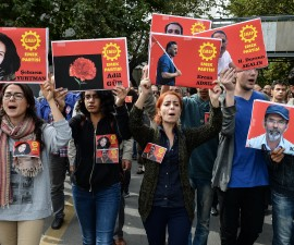 ANKARA, TURKEY - OCTOBER 11: Members of the left-wing Labour Party (EMEP) carry pictures of the victims of Saturday's bomb blasts during a commemoration on October 11, 2015 in Ankara, Turkey. Scuffles broke out as police prevented pro-Kurdish politicians and other mourners from laying carnations at the site of two suspected suicide bombings that killed 95 people and wounded hundreds in Turkey's deadliest attack in years. Police insisted investigators were still working at the site. Turkish PM Davutoglu declares three days of national mourning over Ankara bomb attacks. (Photo by Gokhan Tan/Getty Images)