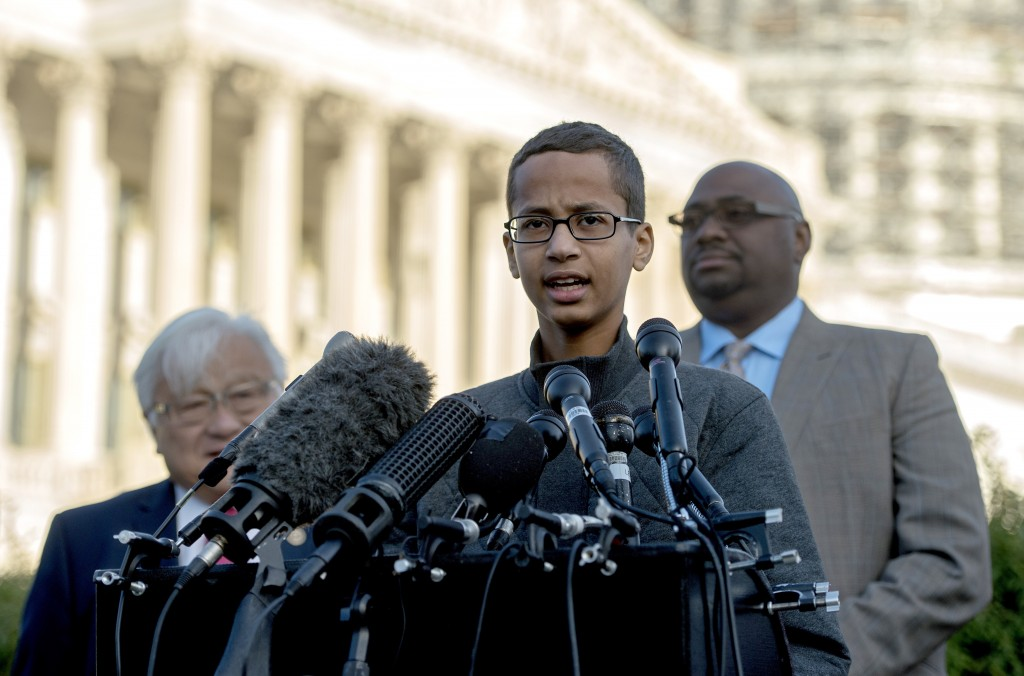 "Ahmed Mohamed (R), a 14-year-old high school student who was arrested after he brought a homemade clock to his Irving, Texas high school to show his teachers and was later accused of having a ""hoax bomb"", speaks during a press conference on Capitol Hill in Washington, DC, October 20, 2015. Ahmeds detention played into national debates about Islam, immigration and ethnicity. Ahmed visited the White House Monday evening following a personal invitation from President Barack Obama. Ahmed, 14, attended the White House's Astronomy Night, along with other students, teachers, scientists and astronauts.  AFP PHOTO/JIM WATSON        (Photo credit should read JIM WATSON/AFP/Getty Images)"