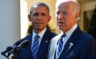 US Vice President Joe Biden (R), flanked by US President Barack Obama (L) speaks in the Rose Garden at the White House on October 21, 2015, in Washington, DC. Biden announced that he is not running for president. AFP PHOTO / JIM WATSON        (Photo credit should read JIM WATSON/AFP/Getty Images)
