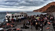 Refugees and migrants arrive at Lesbos island after crossing the Aegean sea from Turkey on October on October 29, 2015. At least seven children died when boats carrying migrants sank off Greece on October 28, as rescue workers battled to save more youngsters on the seashore in the latest desperate scenes in Europe's refugee crisis. Since the start of the year, 560,000 migrants and refugees have arrived in Greece by sea, out of over 700,000 who have reached Europe via the Mediterranean, according to the International Organization for Migration (IOM).AFP PHOTO / ARIS MESSINIS        (Photo credit should read ARIS MESSINIS/AFP/Getty Images)