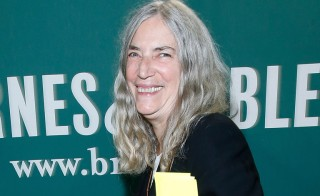 "NEW YORK, NY - OCTOBER 07:  Patti Smith signs copies of ""M Train"" at Barnes & Noble Union Square on October 7, 2015 in New York City. Photo by John Lamparski/WireImage"
