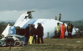 Emergency service workers are seen next to the wreckage of Pan Am flight 103, in a farmer's field east of Lockerbie, Scotland in this December 23, 1988  file photograph. The twentieth anniversary of the bombing of the jumbo jet flight from London to New York will be marked on December 21, 2008.      REUTERS/Greg Bos/Files  (BRITAIN) - RTR22QNB