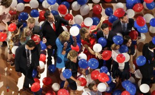 Republican presidential nominee Mitt Romney surrounded by balloons at the Republican National Convention in Tampa, Florida, in 2012. The Republican National Committee announced they would charge news media organizations a $150 access fee for seats on the press stand in 2016. Photo by Rick Wilking/Reuters
