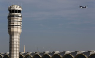 A jet departs Washington's Reagan National Airport next to the control tower outside Washington. Photo by Larry Downing/Reuters