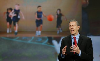 U.S. Secretary of Education Arne Duncan addresses a crowd of teachers and politicians during an event to bring physical activity back to schools, hosted by the American Alliance for Health, Physical Education, Recreation and Dance (AAHPERD) and the Alliance for a Healthier Generation in Chicago, Illinois on Feb. 28, 2013. Photo by Jeff Haynes/Reuters