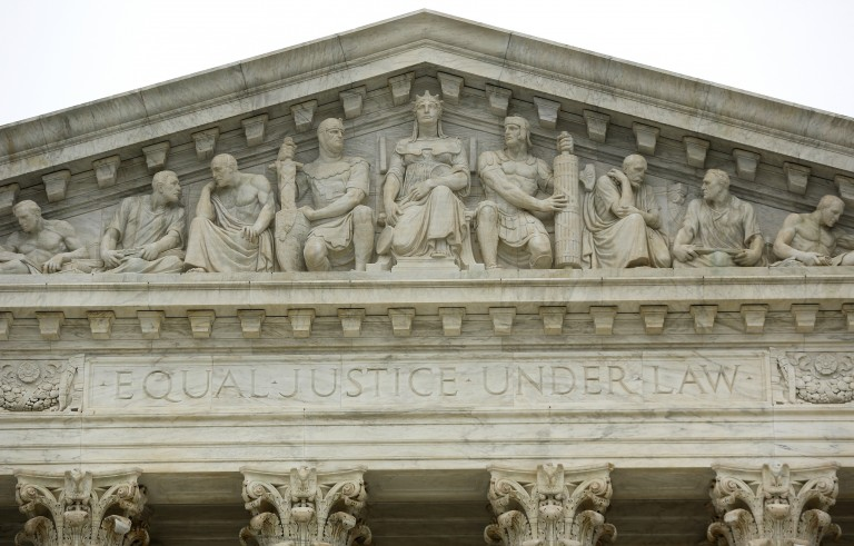 "The phrase ""equal justice under law"" adorns the west entrance to the Supreme Court building in Washington, DC, December 3, 2014. The Court will hear arguments Monday related to the selection of an all-white jury in a decades-old Georgia murder case in which the defendant, Timothy Tyrone Foster, was black. Photo by Jonathan Ernst/Reuters"
