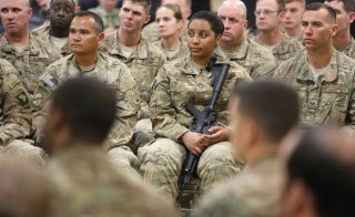 Soldiers listen as U.S. Secretary of Defense Ash Carter (not pictured) holds a question-and-answer session with U.S. military personnel at Kandahar Airfield in Kandahar, Afghanistan on Feb. 22, 2015. President Barack Obama is expected to announce Thursday morning the decision to keep 5,500 U.S. troops in Afghanistan when he leaves office in 2017. Photo by Jonathan Ernst/Reuters