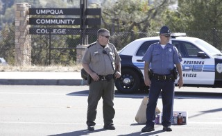 Police officers stand guard near the site of a mass shooting at Umpqua Community College in Roseburg, Ore., on Oct. 1, 2015. A gunman opened fire at UCC, killing at least nine people before he was shot to death by police in a shootout. Photo by Steve Dipaola/Reuters