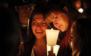 People take part in candle light vigil following the mass shooting at Umpqua Community College in Roseburg, Oregon. Photo by Steve Dipaola/Reuters
